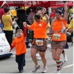 one of my favourite race pictures of all time - finishing the 10K with Nolan and his mom in 2012
